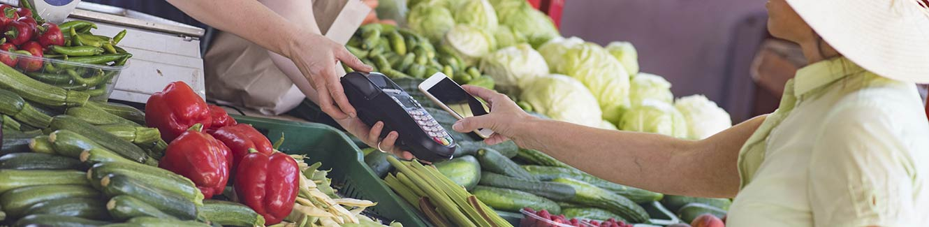 Small produce business with a card reader for transactions.