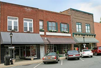 Small town businesses in a downtown setting.