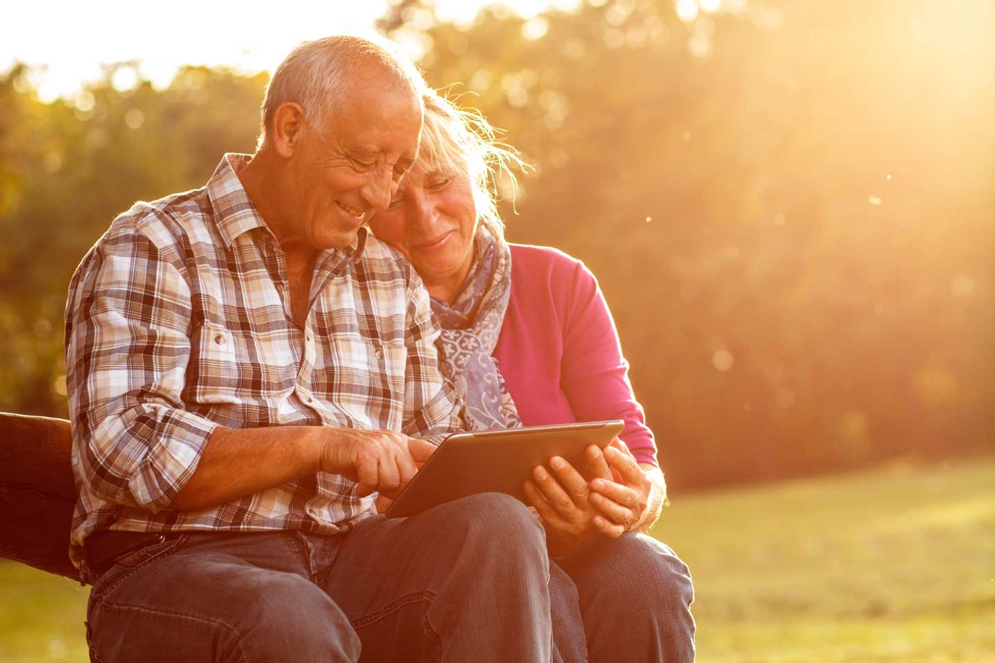 Older couple using a tablet.